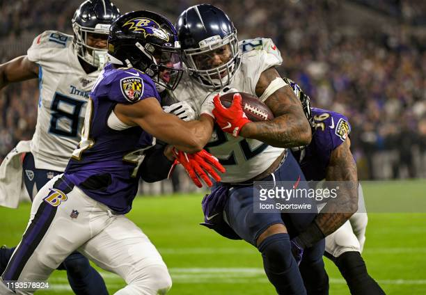 Tennessee Titans running back Derrick Henry runs the ball against Baltimore Ravens inside linebacker Patrick Onwuasor on January 11 at M&T Bank...