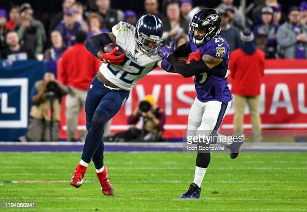 Tennessee Titans running back Derrick Henry runs the ball against Baltimore Ravens free safety Earl Thomas III on January 11 at MT Bank Stadium in...
