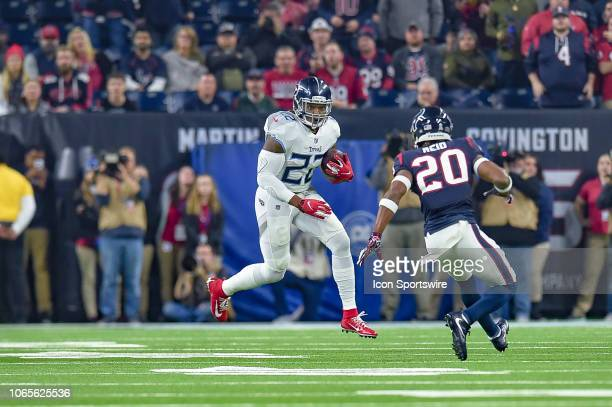 Tennessee Titans running back Derrick Henry runs the ball during the football game between the Tennessee Titans and Houston Texans on November 26...