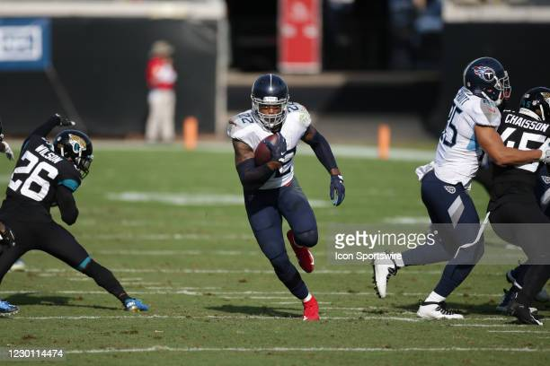 Tennessee Titans Running Back Derrick Henry runs with the ball during the game between the Tennessee Titans and the Jacksonville Jaguars on December...