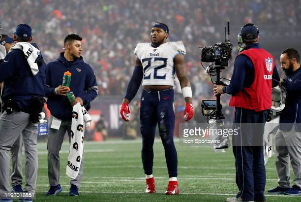 Tennessee Titans running back Derrick Henry watches a replay waiting on video review during an AFC Wild Card game between the New England Patriots...