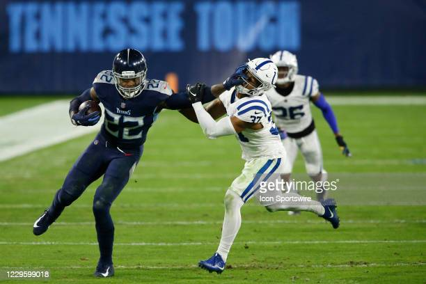 Tennessee Titans Running Back Derrick Henry with the stiff arm to the face of Indianapolis Colts Safety Khari Willis in game action during a NFL game...
