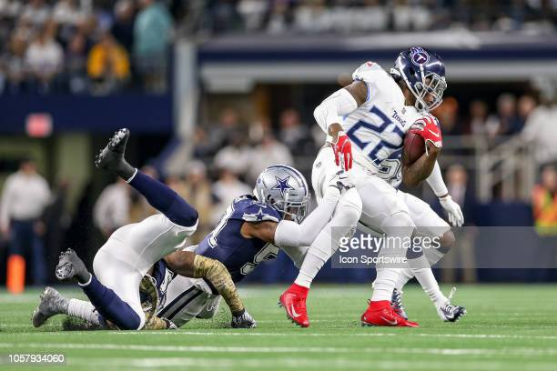 Tennessee Titans running back Derrick Henry works through a tackle by Dallas Cowboys defensive tackle Caraun Reid during the game between the...
