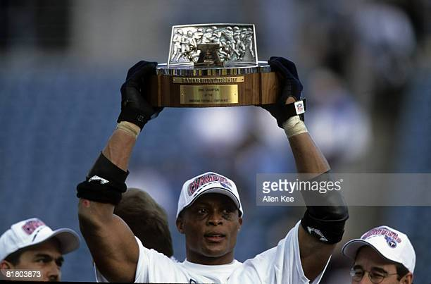 Tennessee Titans running back Eddie George holds up the Lamar Hunt Trophy following the Titans 3314 victory over the Jacksonville Jaguars in the 1999...