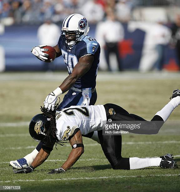 Tennessee Titans running back Travis Henry is tackled by Jacksonville Jaguars cornerback Rashean Mathis. The Tennessee Titans defeated the...
