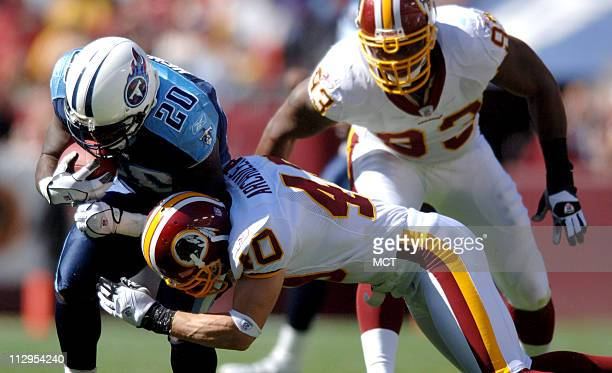 Tennessee Titans running back Travis Henry is tackled by Washington Redskins' Adam Archuleta during the first quarter at FedEx Field in Washington DC...