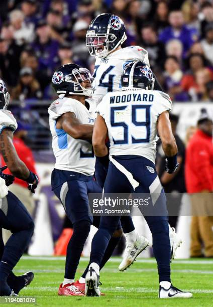 Tennessee Titans strong safety Kenny Vaccaro celebrates with Tennessee Titans inside linebacker Wesley Woodyard and linebacker David Long Sr after...