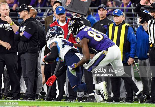 Tennessee Titans strong safety Kenny Vaccaro intercepts a pass intended for Baltimore Ravens wide receiver Miles Boykin on January 11 at MT Bank...