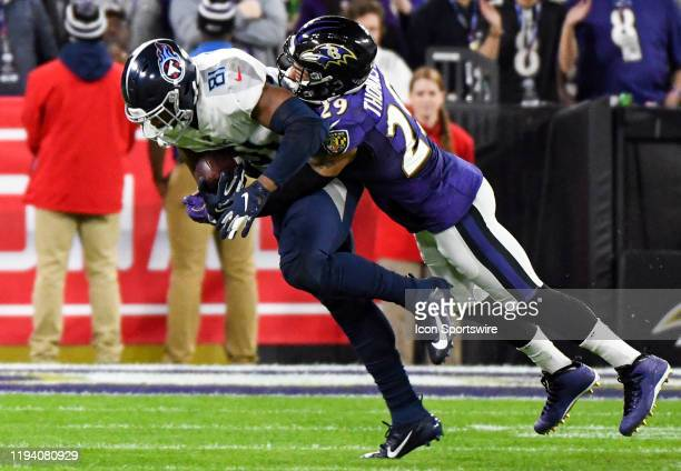 Tennessee Titans wide receiver AJ Brown makes a reception against Baltimore Ravens free safety Earl Thomas III on January 11 at MT Bank Stadium in...
