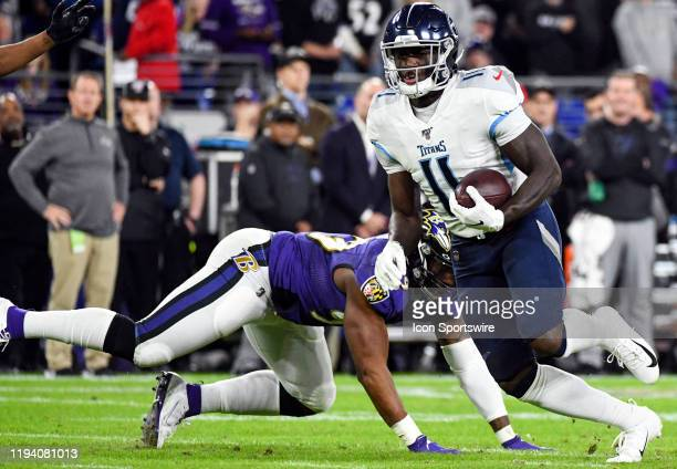 Tennessee Titans wide receiver AJ Brown makes a reception on January 11 at MT Bank Stadium in Baltimore MD in the AFC Divisional Playoff against the...