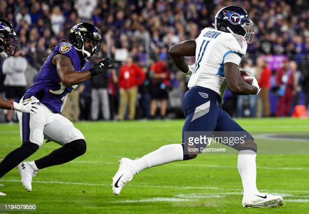 Tennessee Titans wide receiver AJ Brown takes a hand off on January 11 at MT Bank Stadium in Baltimore MD in the AFC Divisional Playoff game against...
