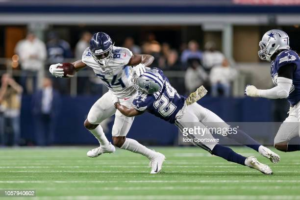 Tennessee Titans wide receiver Corey Davis attempts to break a tackle by Dallas Cowboys cornerback Chidobe Awuzie during the game between the...