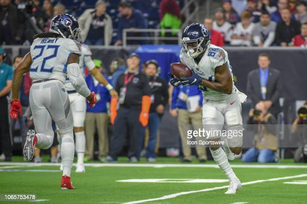Tennessee Titans Wide Receiver Corey Davis finds the handle on the ball after receiving a pitch on a reverse end around during the football game...