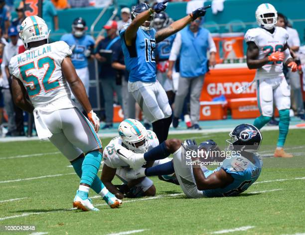 Tennessee Titans Wide Receiver Corey Davis gets tackled by Miami Dolphins Cornerback Xavien Howard between the Miami Dolphins and Tennessee Titans on...