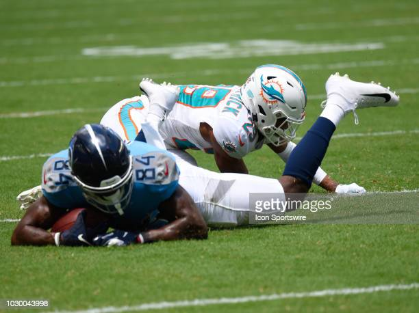 Tennessee Titans Wide Receiver Corey Davis gets tackled by Miami Dolphins Safety Minkah Fitzpatrick between the Miami Dolphins and Tennessee Titans...