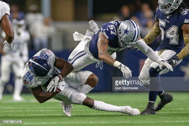 Tennessee Titans wide receiver Corey Davis is tackled by Dallas Cowboys outside linebacker Damien Wilson during the game between the Tennessee Titans...