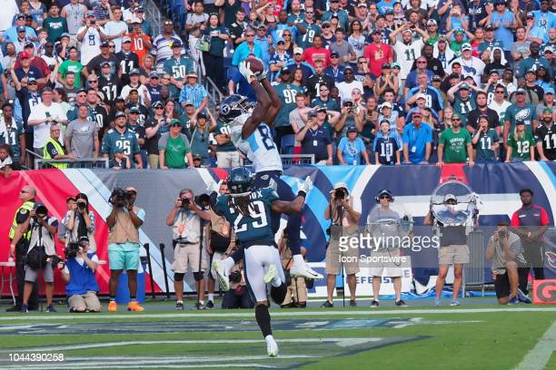 Tennessee Titans Wide Receiver Corey Davis leaps over Philadelphia Eagles Cornerback Avonte Maddox for the overtime touchdown during the football...