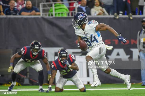 Tennessee Titans Wide Receiver Corey Davis leaves Houston Texans safety Andre Hal and Houston Texans Cornerback Johnathan Joseph watching as he...