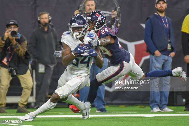 Tennessee Titans Wide Receiver Corey Davis slips from a tackle attempt by Houston Texans Cornerback Johnathan Joseph enroute to a touchdown reception...