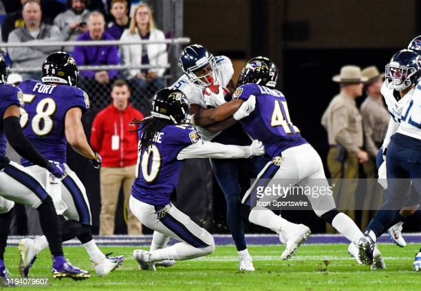 Tennessee Titans wide receiver Darius Jennings brings a kickoff back and is stopped by Baltimore Ravens defensive back Anthony Levine Sr and wide...