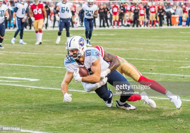 Tennessee Titans wide receiver Eric Decker gets taken down near the 8yard line after completing a pass reception during the game between the...