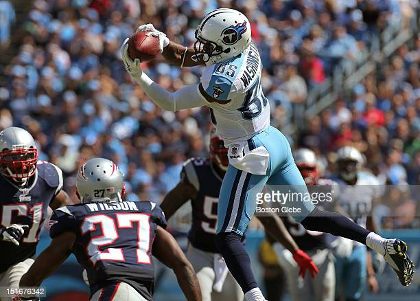 Tennessee Titans wide receiver Nate Washington appears to make a pass reception before he was hit by New England Patriots free safety Tavon Wilson ,...