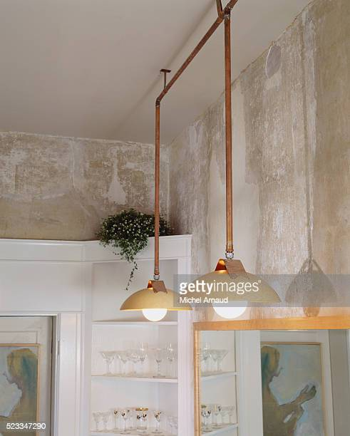tennessee traditional horse farm: hanging lamps of copper pipe - pendant light stock pictures, royalty-free photos & images