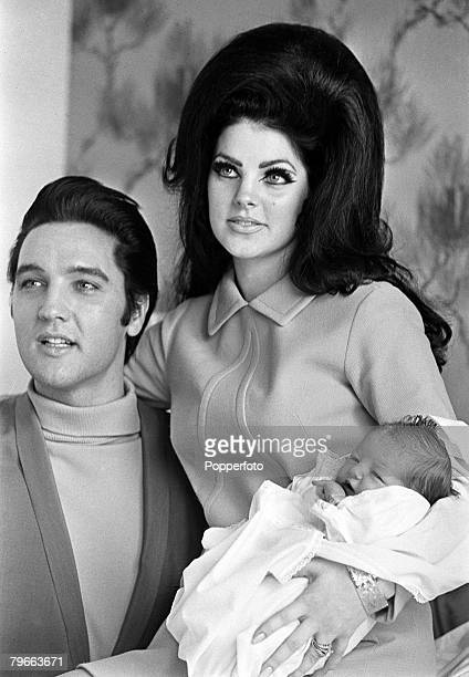 Tennessee USA 5th February 1968 Rock Roll star Elvis Presley with his wife Priscilla proudly show their new born baby 4 day old Lisa Marie at the...