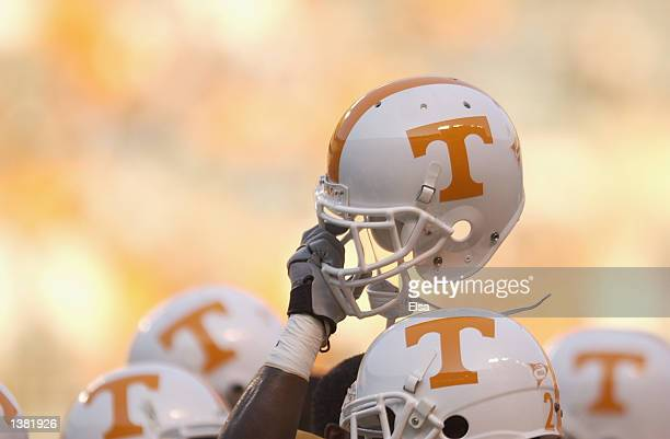 Tennessee Volunteer holds up his helmet in the team huddle before the NCAA football game against the Middle Tennessee State Blue Raiders at Neyland...