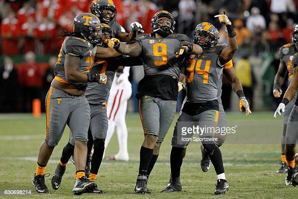 Tennessee Volunteers celebrate with Tennessee Volunteers defensive end Derek Barnett after setting the sack record for the Vols The Tennessee...