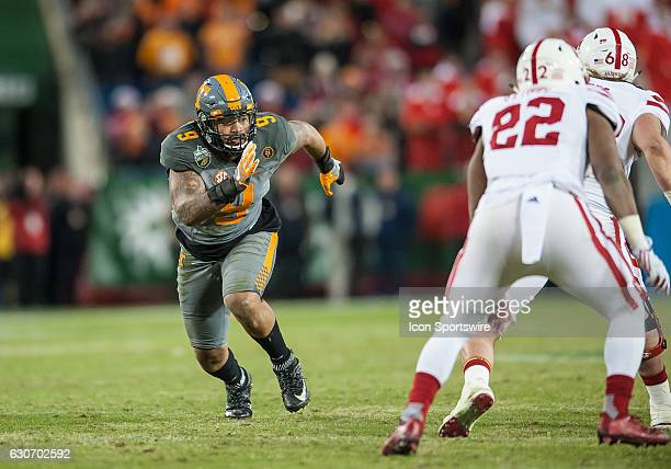 Tennessee Volunteers defensive end Derek Barnett rushes around the end during the Music City Bowl between the Tennessee Volunteers and Nebraska...