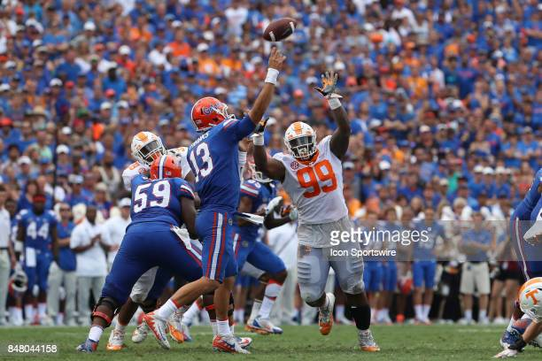 Tennessee Volunteers defensive lineman Reginald McKenzie Jr puts pressure on Florida Gators quarterback Feleipe Franks during the college football...