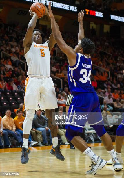 Tennessee Volunteers forward Admiral Schofield shoots over High Point Panthers forward Jordan Whitehead during a game between the High Point Panthers...