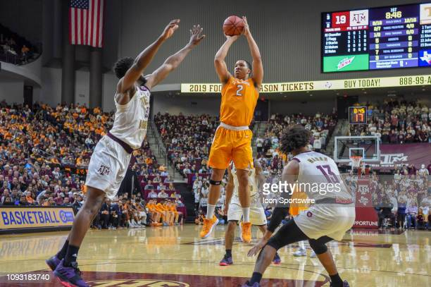 Tennessee Volunteers forward Grant Williams takes a first half jumper from the free throw line as Texas AM Aggies forward forward Josh Nebo defends...