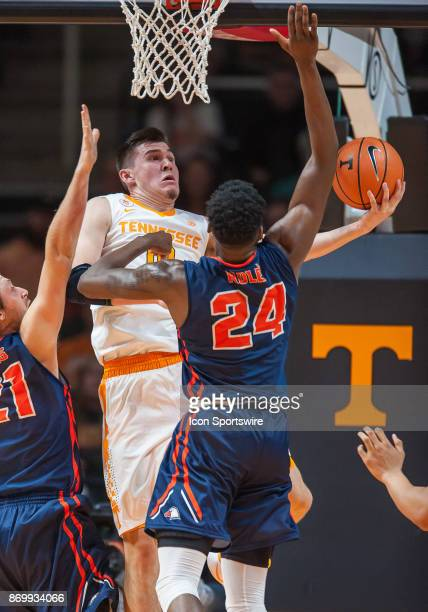 Tennessee Volunteers forward John Fulkerson drives to the basket and shoots around CarsonNewman forward Parker Role' during a game between the...