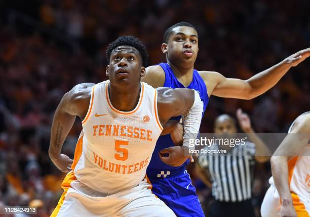 Tennessee Volunteers guard Admiral Schofield blocking out Kentucky Wildcats guard Keldon Johnson during a college basketball game between the...