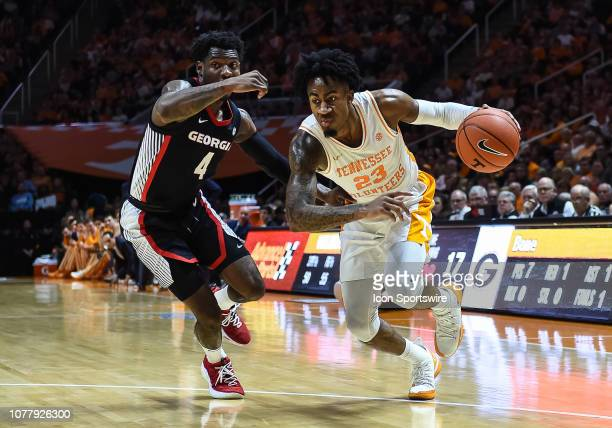 Tennessee Volunteers guard Jordan Bowden drives past Georgia Bulldogs guard Tyree Crump during a college basketball game between the Tennessee...
