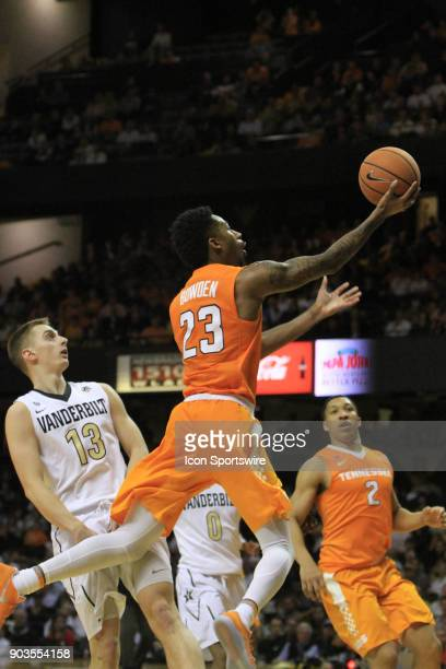 Tennessee Volunteers guard Jordan Bowden drives past Vanderbilt Commodores guard Riley LaChance for a layup during a regular season game between the...