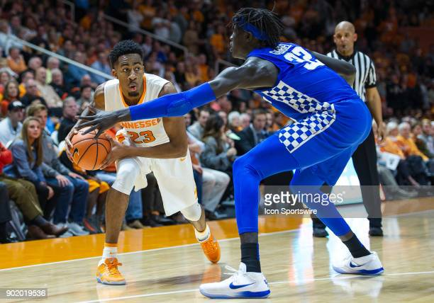 Tennessee Volunteers guard Jordan Bowden is guarded by Kentucky Wildcats forward Wenyen Gabriel during a game between the Kentucky Wildcats and...