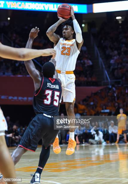 Tennessee Volunteers guard Jordan Bowden takes a shot over Louisiana Ragin Cajuns guard Marcus Stroman during a college basketball game between the...