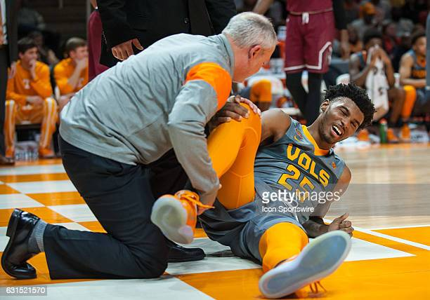 Tennessee Volunteers guard Shembari Phillips is looked at by Tennessee medical staff after suffering and injury during a game between the South...