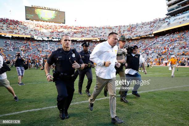 Tennessee Volunteers head coach Butch Jones leaves the field after a game against the Georgia Bulldogs at Neyland Stadium on September 30 2017 in...