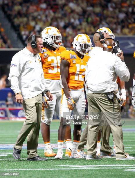 Tennessee Volunteers head coach Butch Jones speaks with his boys during the ChickfilA Kickoff college football game between the Georgia Tech Yellow...