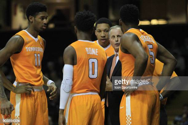 Tennessee Volunteers head coach instructs his team during a timeout against the Vanderbilt Commodores in a regular season game between the Vanderbilt...
