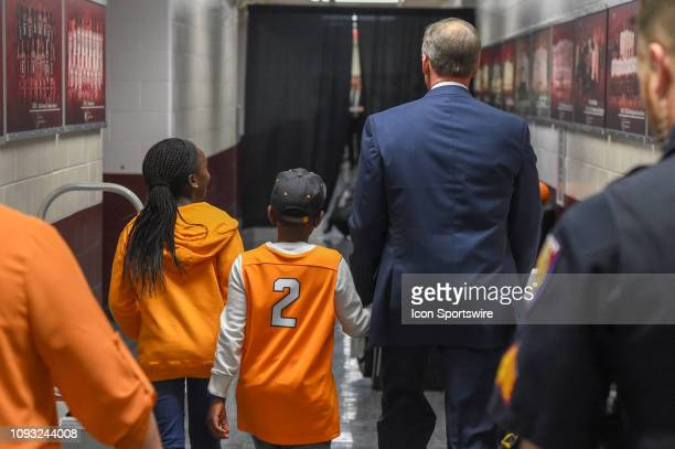 Tennessee Volunteers head coach Rick Barnes escorts to young Volunteer fans to the locker room following the basketball game between the Tennessee...