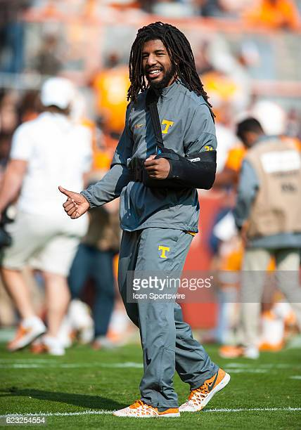 Tennessee Volunteers linebacker Jalen Reeves-Maybin , out for the season with a shoulder injury, walks across the field before a game between the...