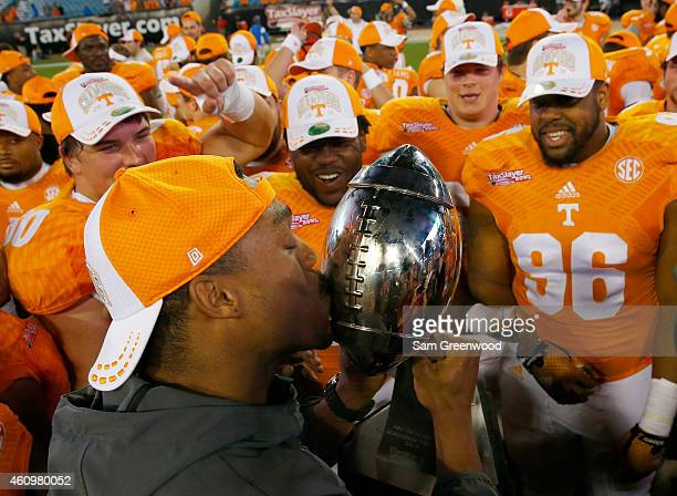 Tennessee Volunteers players celebrate following the TaxSlayer Bowl against the Iowa Hawkeyes at EverBank Field on January 2 2015 in Jacksonville...