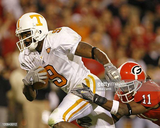 Tennessee WR Bret Smith drags Georgia defender Ramarcus Brown across the field during the game between the Georgia Bulldogs and the Tennessee...