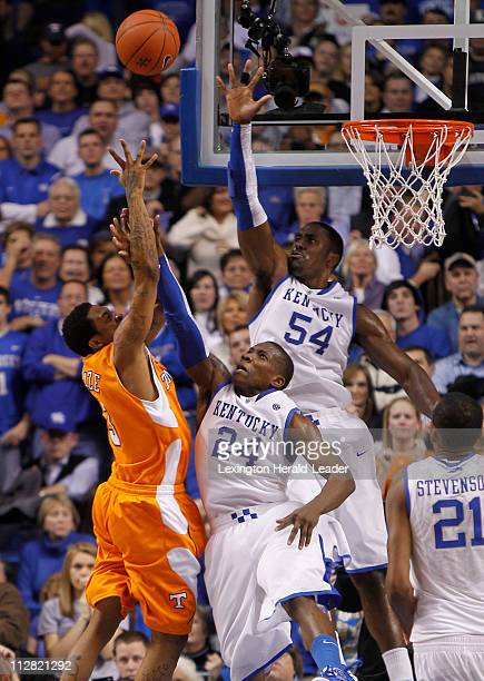 Tennessee's Bobby Maze tries to shoot over Eric Bledsoe and Patrick Patterson as Kentucky defeated Tennessee, 73-62, at Rupp Arena in Lexington,...