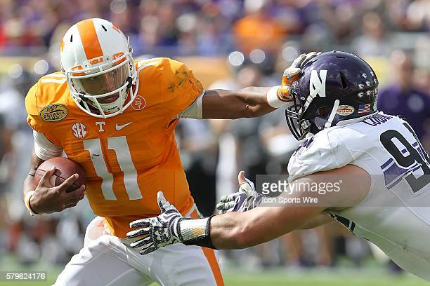 Tennessee's Joshua Dobbs avoids a Northwestern defender during the Outback Bowl game between the Northwestern Wildcats and Tennessee Volunteers at...
